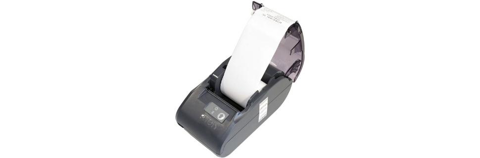 Как вставить бумагу в кассовый аппарат и заправить ленту